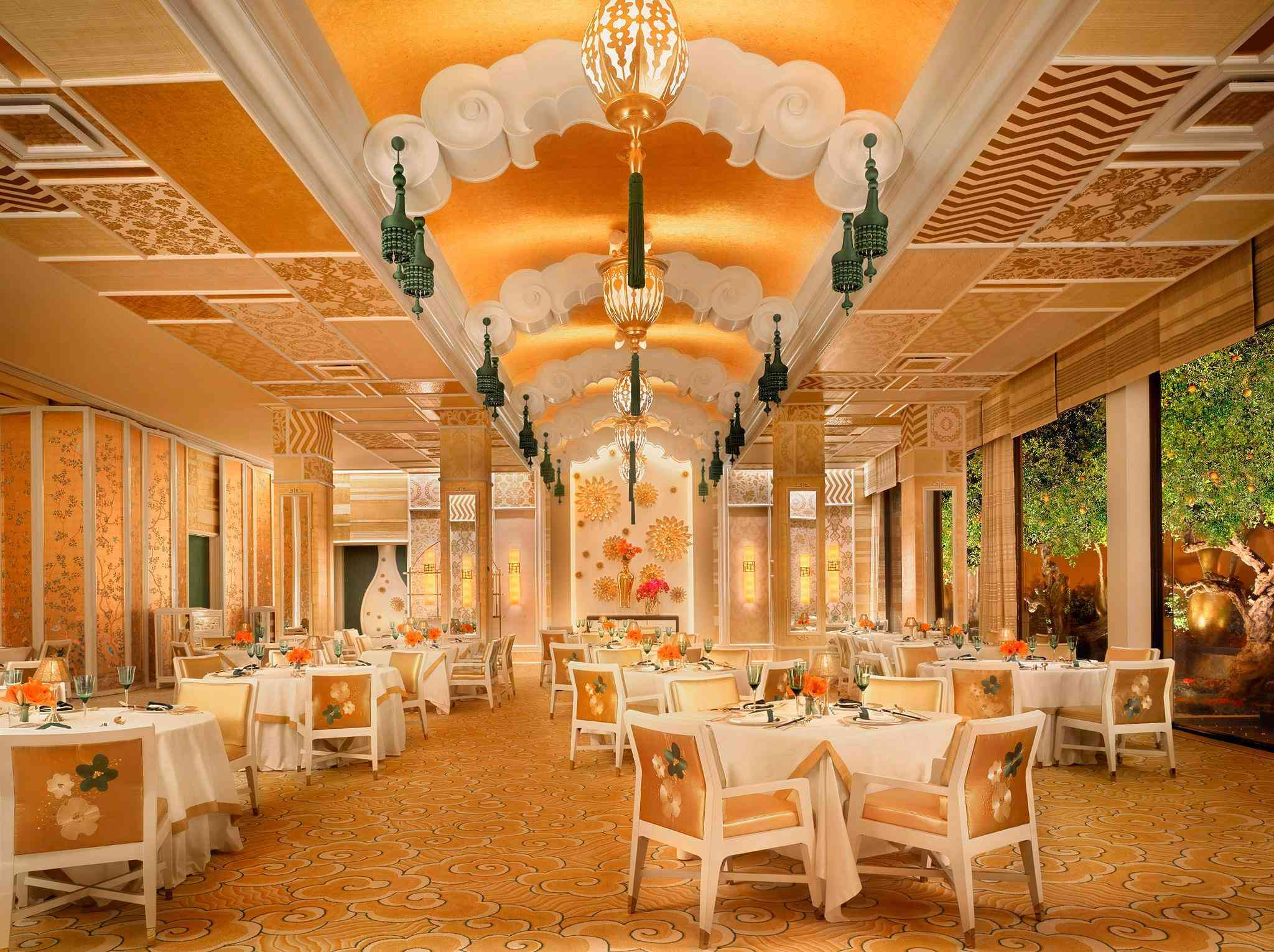 Interior dining room of Wing Lei decorated in gold and floral accents