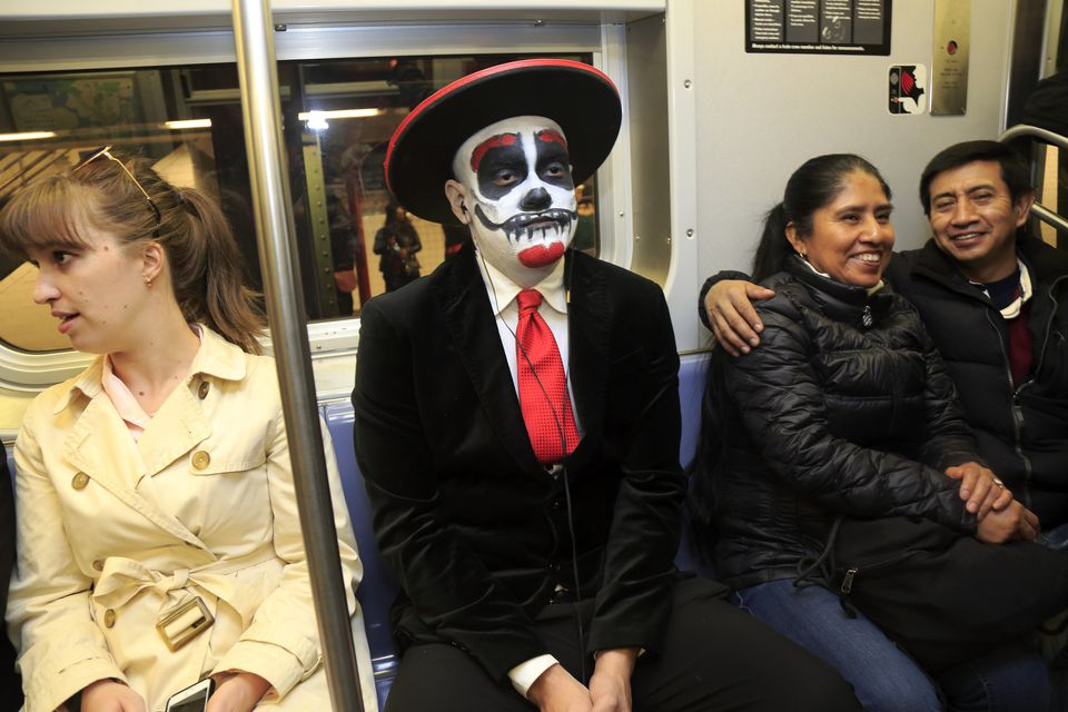a man in halloween costume in subway car