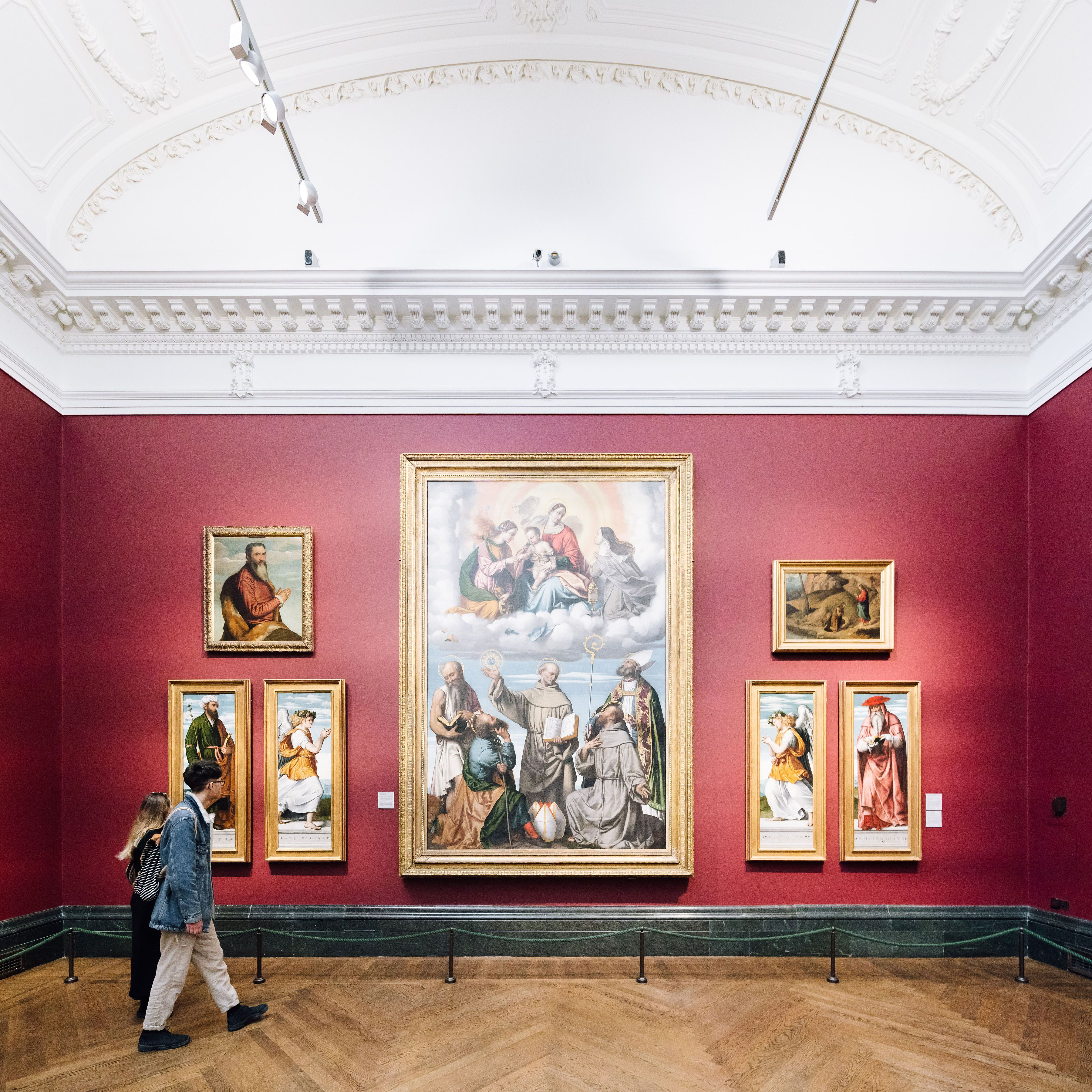 People observing art in a museum