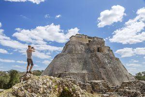 Mexico, Yucatan, Uxmal, Tourist visiting Mayan ruins