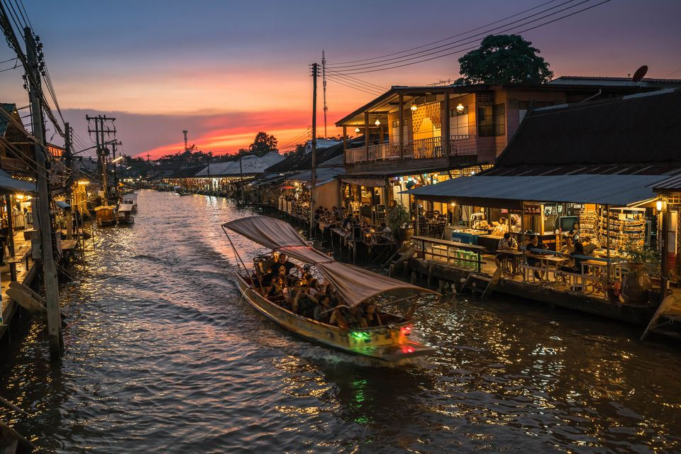 Amphawa floating market at sunset