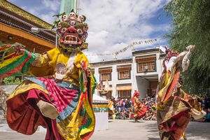 Mask dancers perform at a Buddhist monastery for the Ladakh Festival