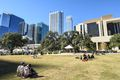 People on a grassy lawn in downtown Austin