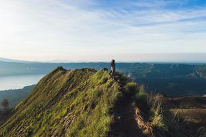 Beautiful woman at the top of Mount Batur, Bali, Indonesia
