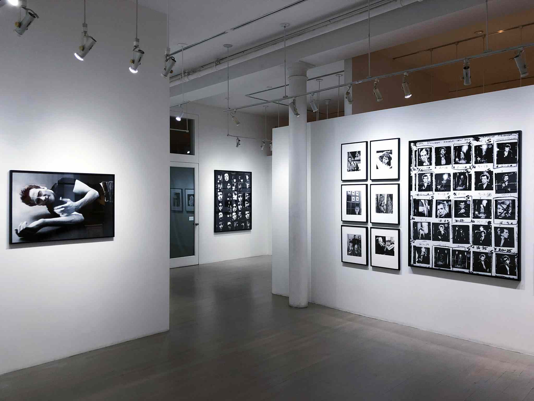 White gallery walls with black and white photographs