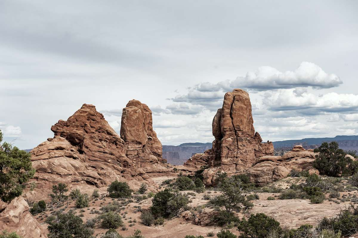 Rock formations rise from the desert landscape