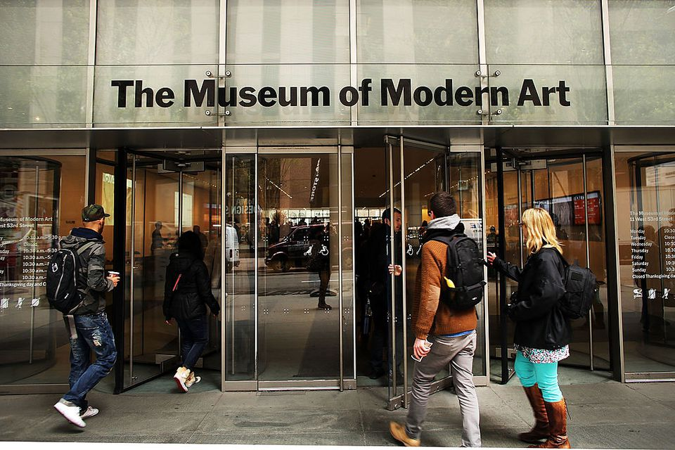 People walk into the Museum of Modern Art in New York City