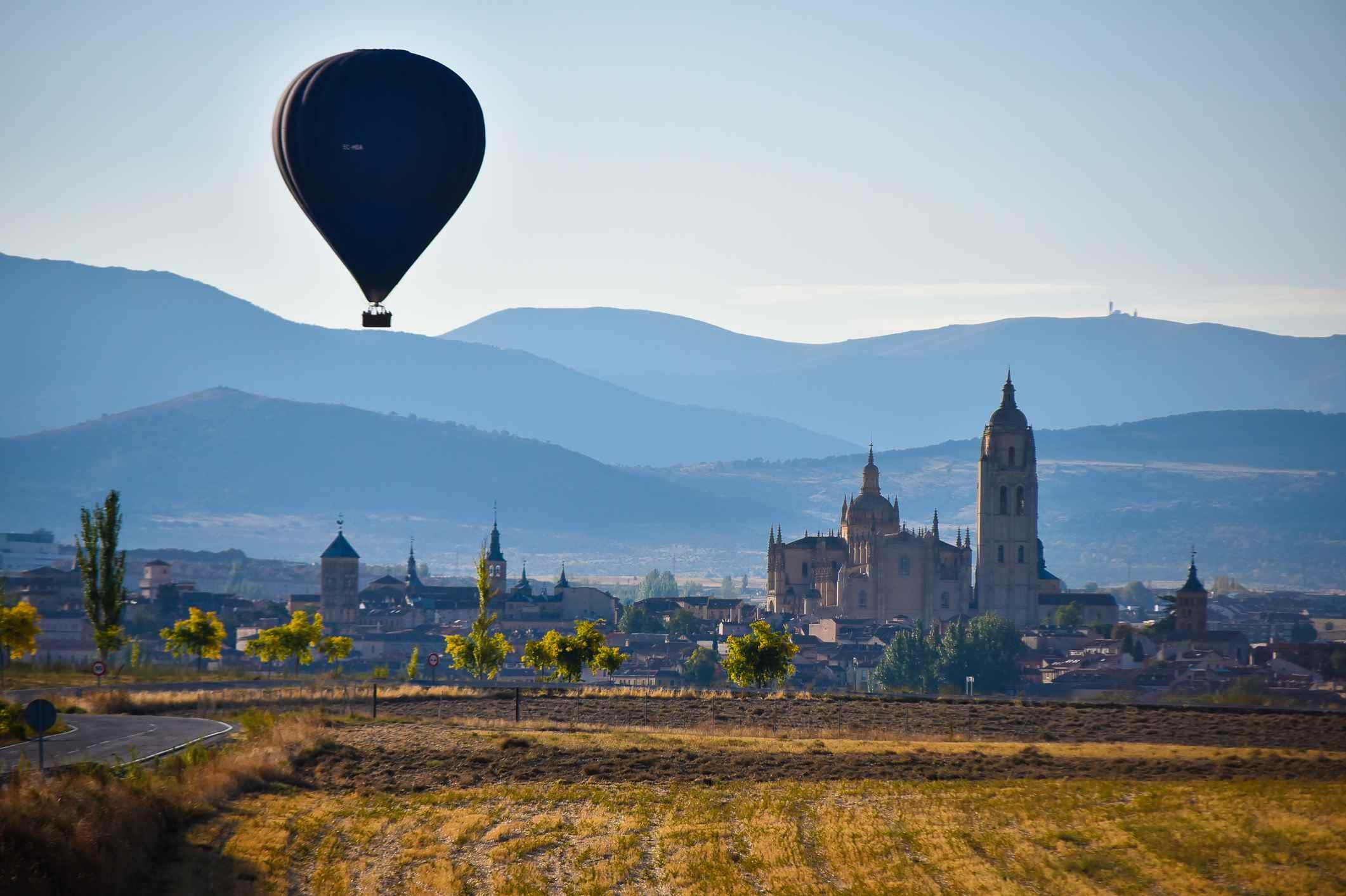 Hot air balloon flying over Segovia Spain