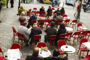 People sitting at a cafe in Paris