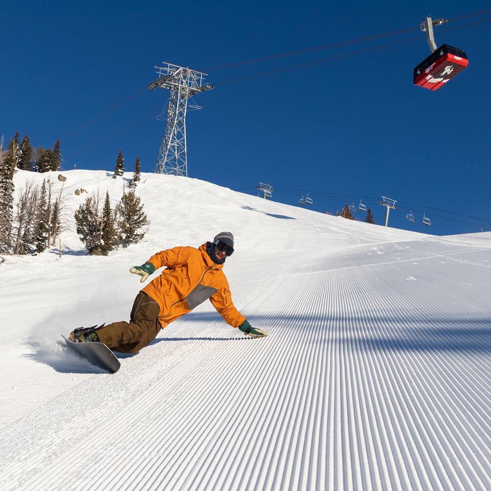 A man snowboarding at Jackson Hole Mountain Resort in Wyoming