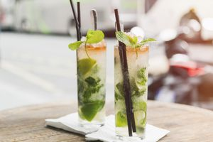 Two glasses of Mojito on table of sidewalk cafe