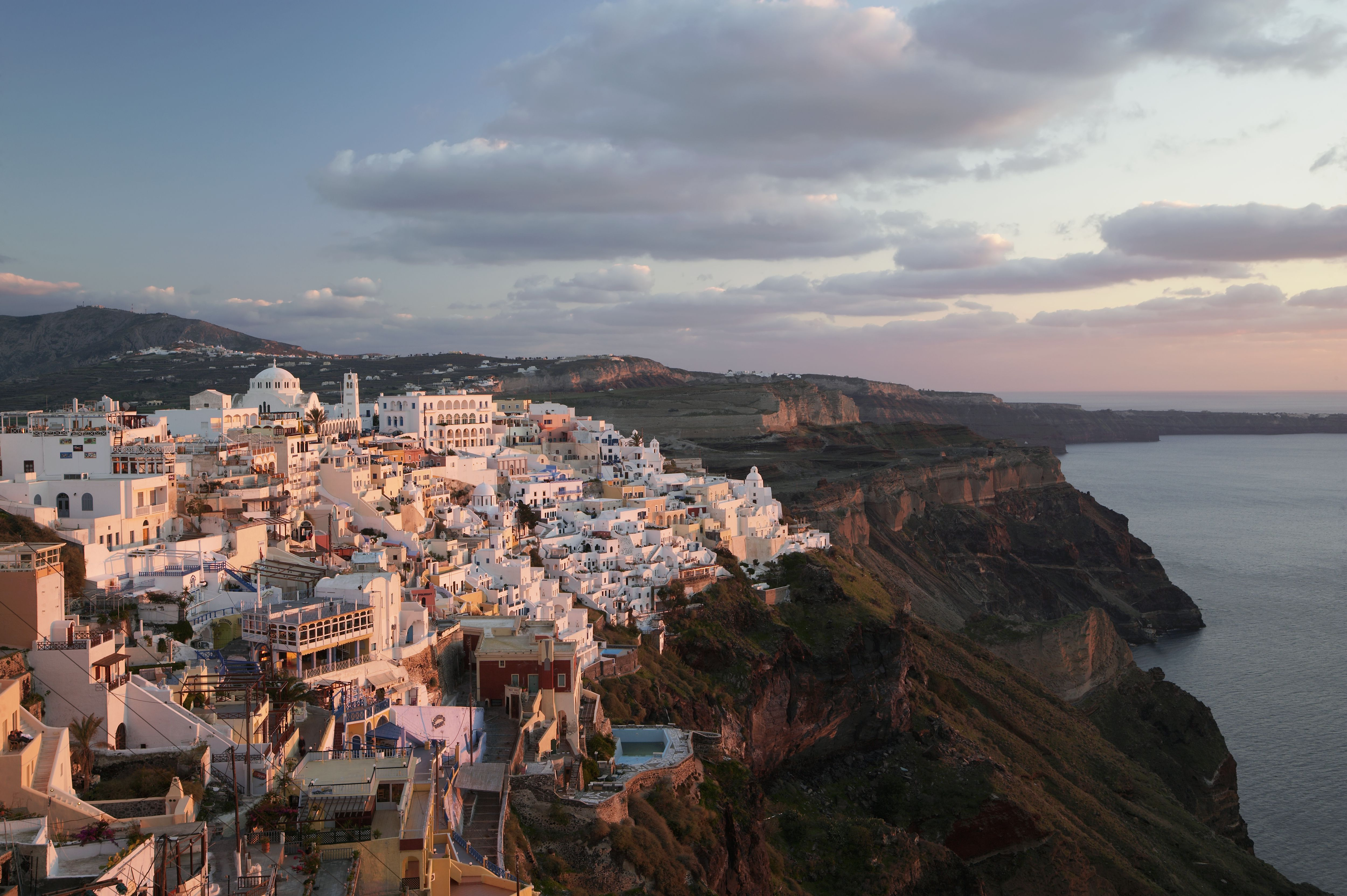 Greece, Santorini, Fira, cityscape, elevated view, dusk