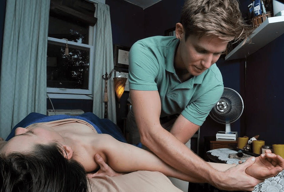 Massage therapist Matthew Behr, gives a massage. Behr incorporates cannabis-infused muscle balm into his medicated massages.