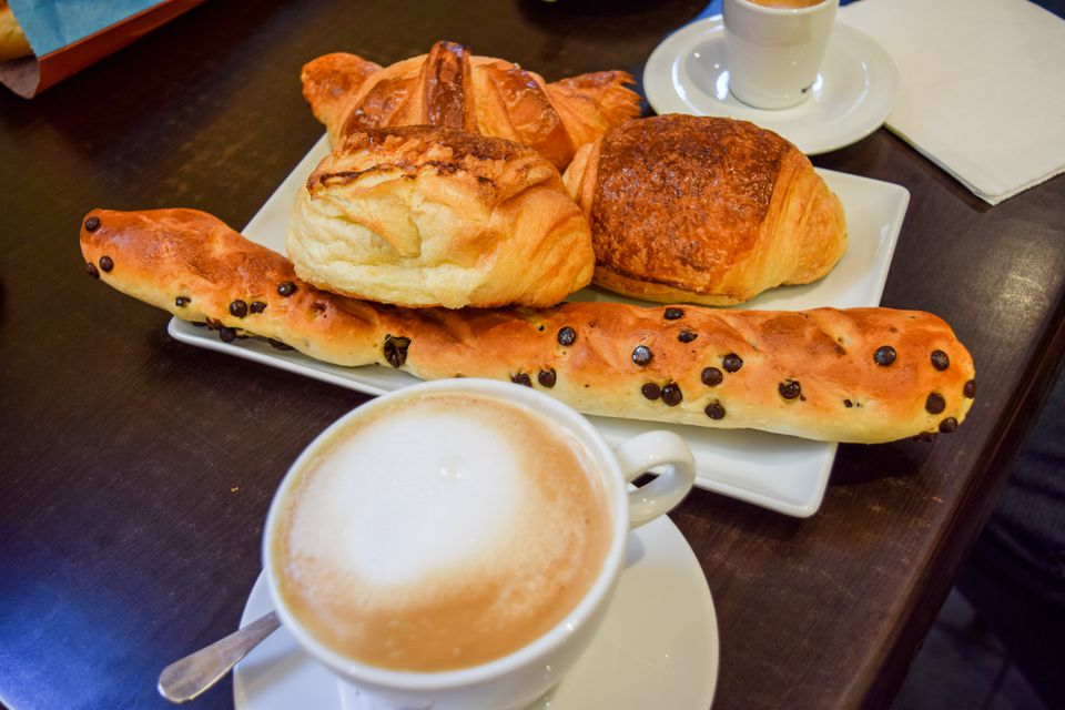 Plate filled with croissants and other baked goods