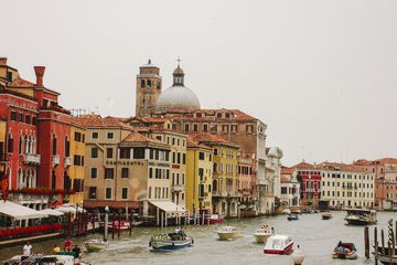 boats cruising down the main waterway in Venice