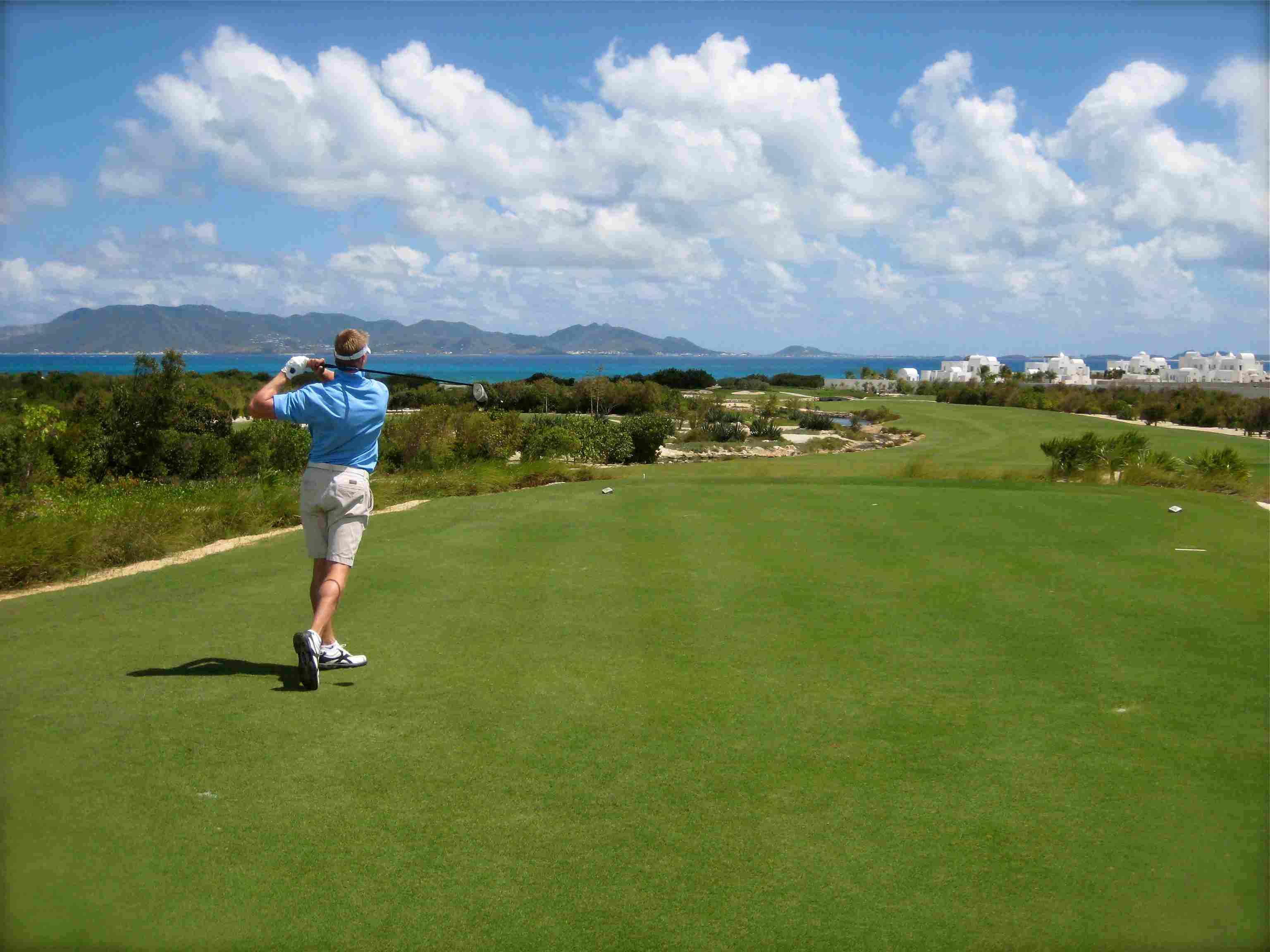 Golfer swinging at the CuisinArt Golf Resort & Spa in Anguilla