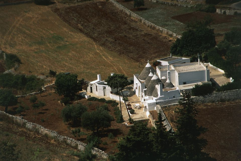 Masseria (fortified farm house) with trulli (conic stone roof houses)