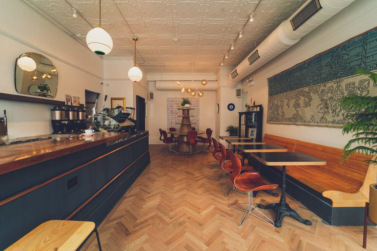 interior of Four Letter Word Coffee shop with no patrons