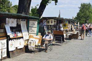 Vendor stands along walkway in Paris, France