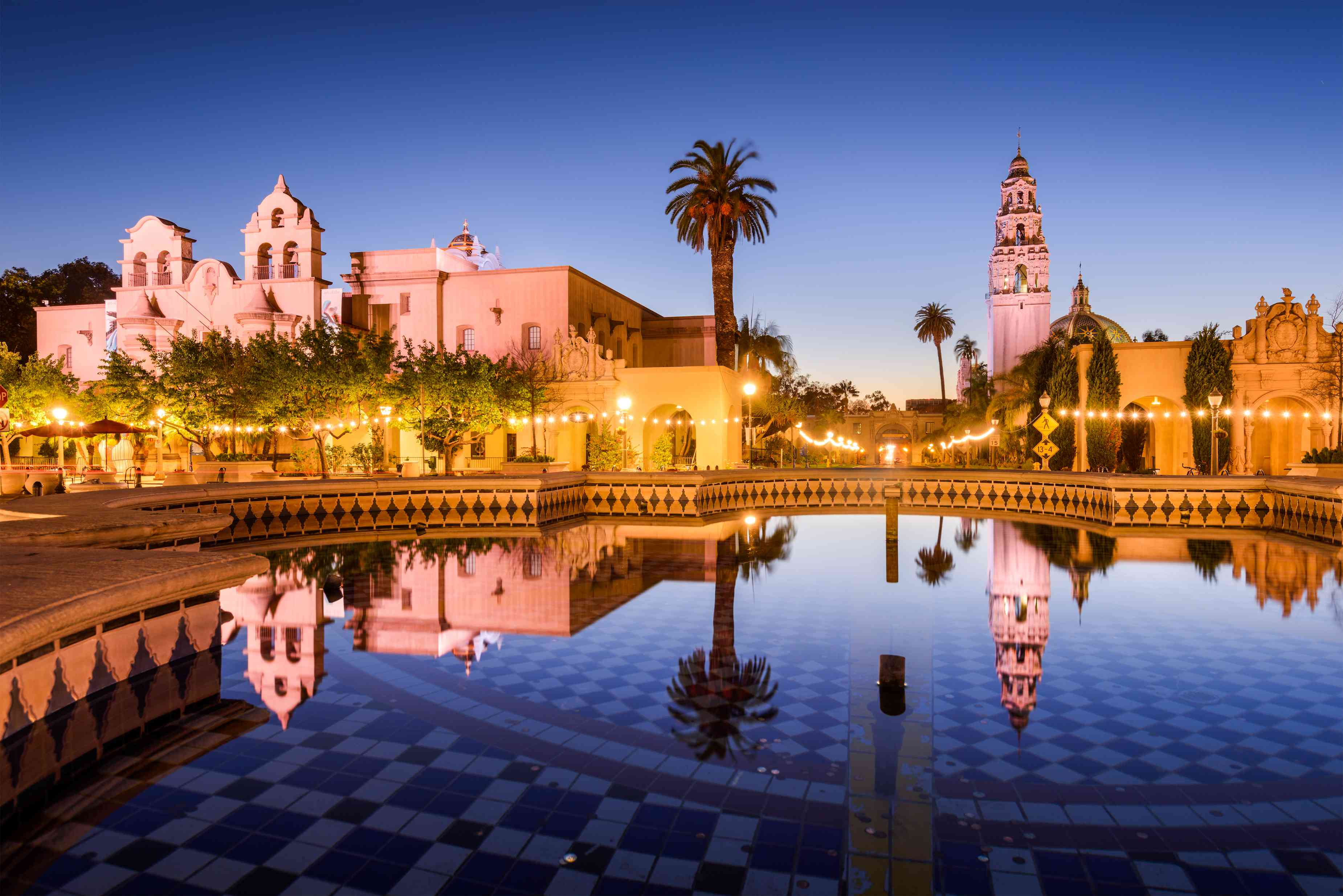 Spanish architecture and a reflecting pool in Balboa Park at Sunset