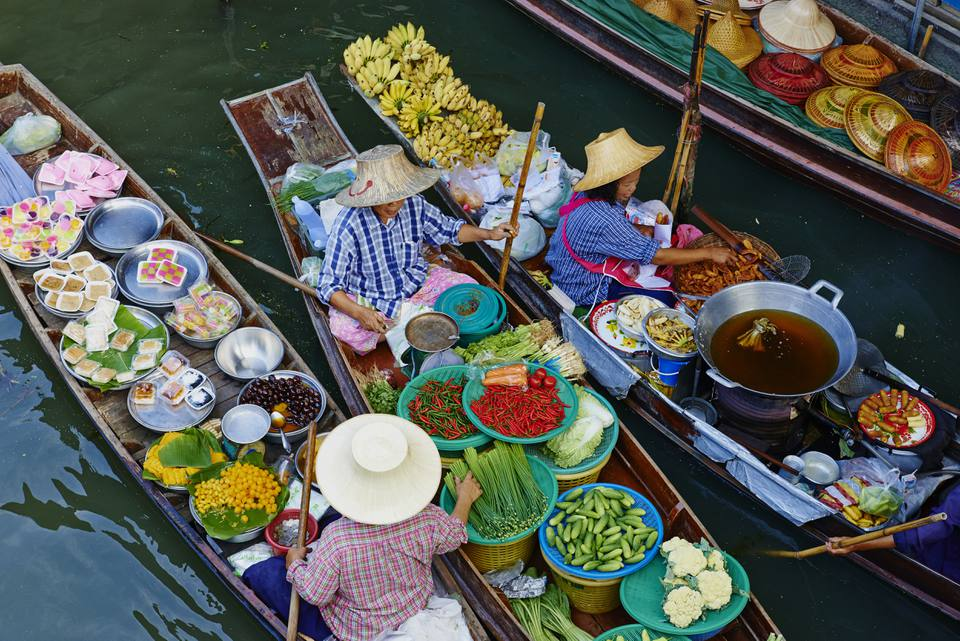 Thai women in boats at a floating market near Bangkok
