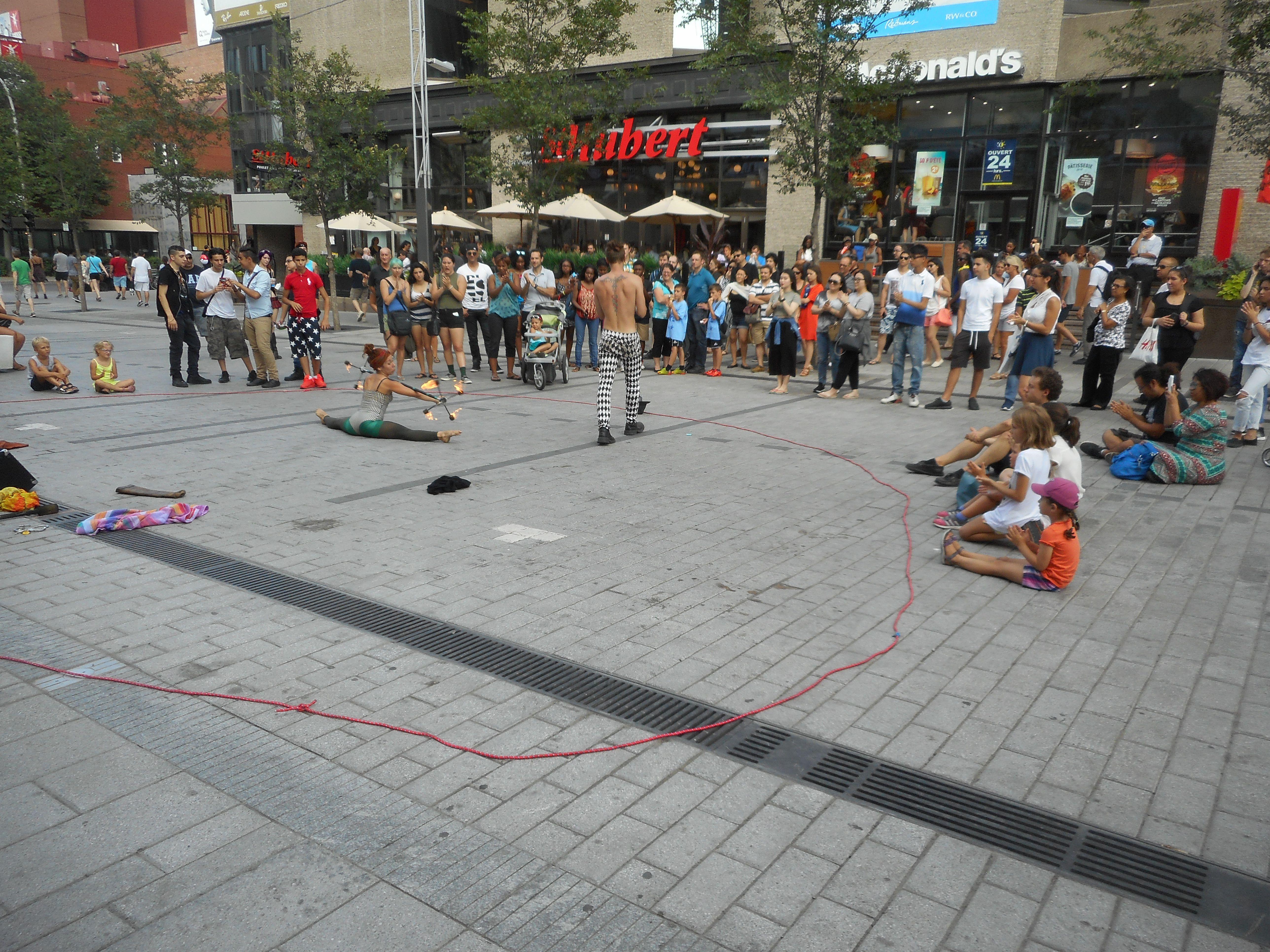 Street performers on Sainte-Catherine Street in Montreal.