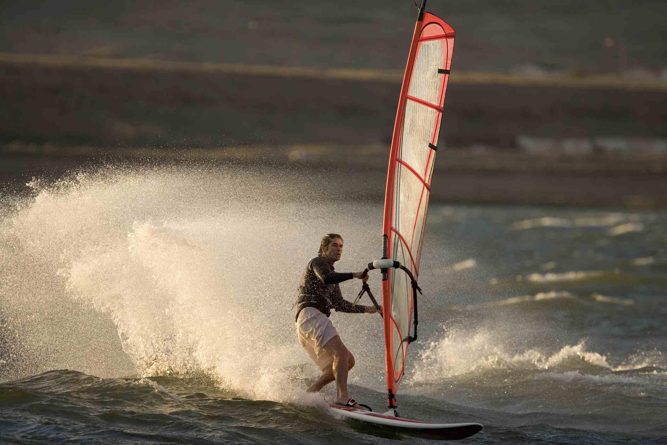 Windsurfer maneuvering through waves.