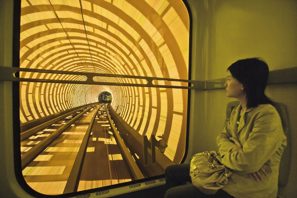 Woman riding train in Bund Sightseeing Tunnel