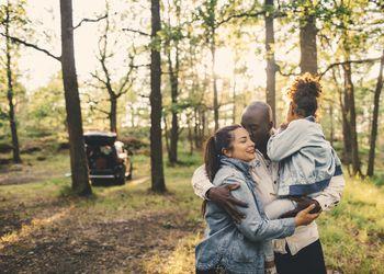 Family hugging in wilderness