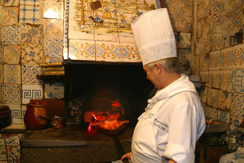 Roasting a pig at the historic oven in El Botin, Madrid
