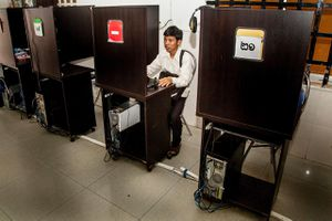 A young Cambodian checks social media from an internet cafe in Phnom Penh, Cambodia.