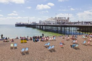 View of beach at Brighton Pier, England.