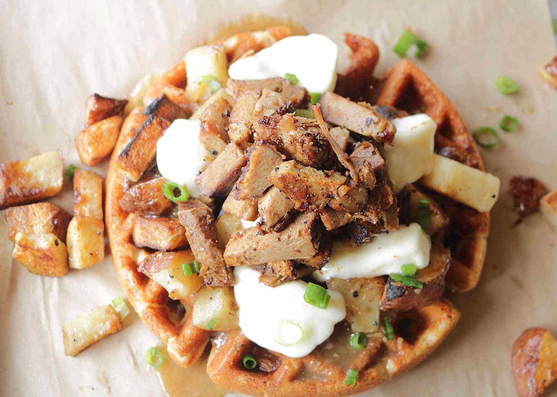 Gluten-free waffle topped with brisket poutine