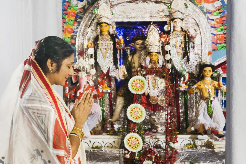 Woman praying during Navaratri.