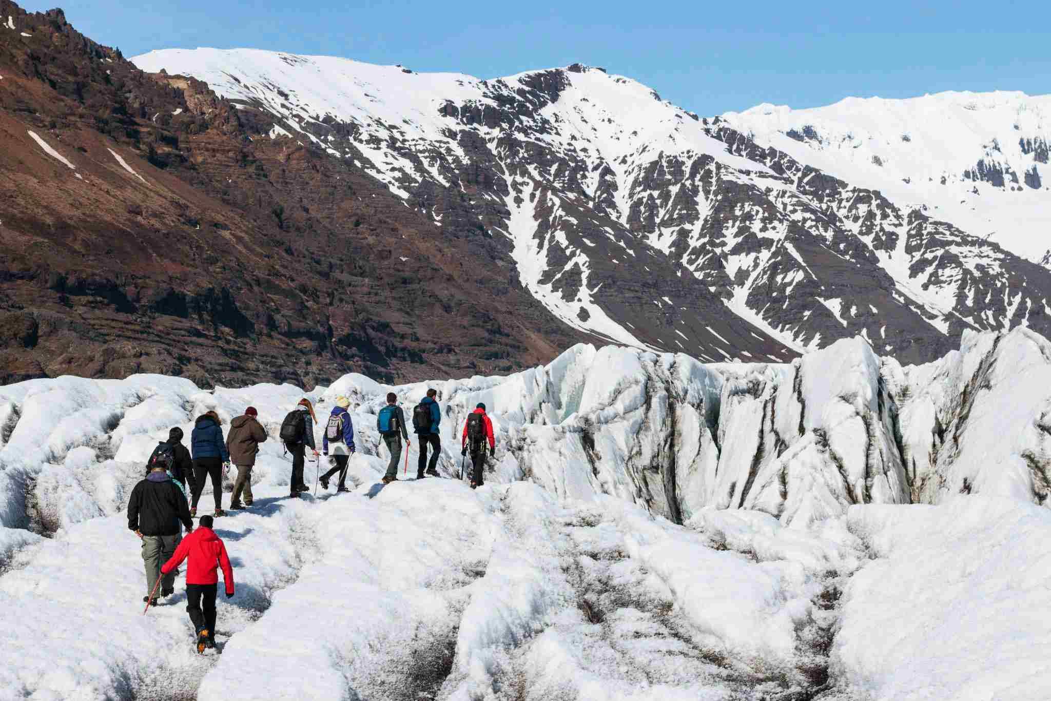 People hiking through the Vatajokull Glacier