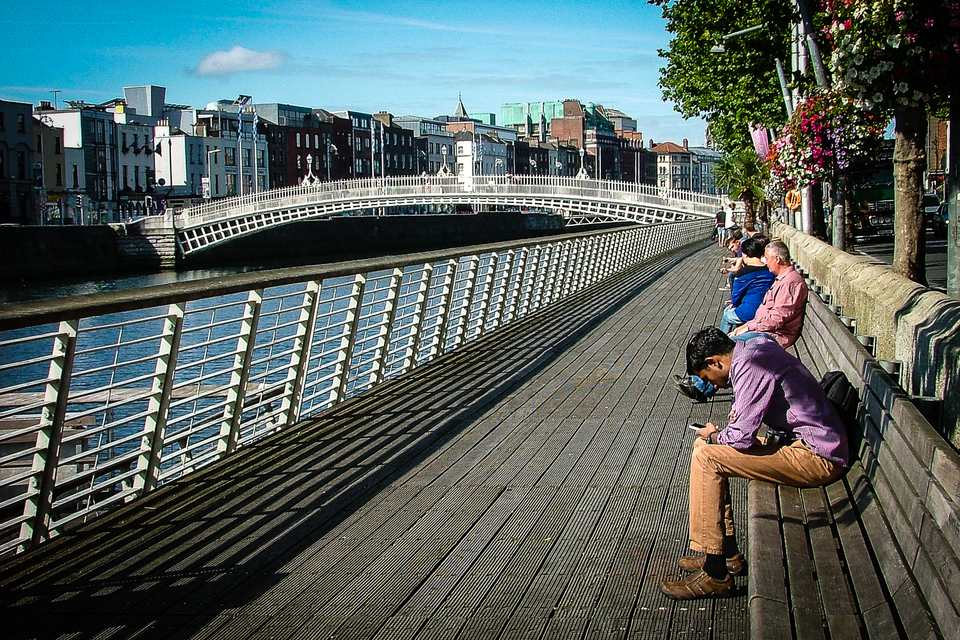 Heading towards Ha'penny Bridge on the Liffey Boardwalk - a pleasant stroll on a sunny day