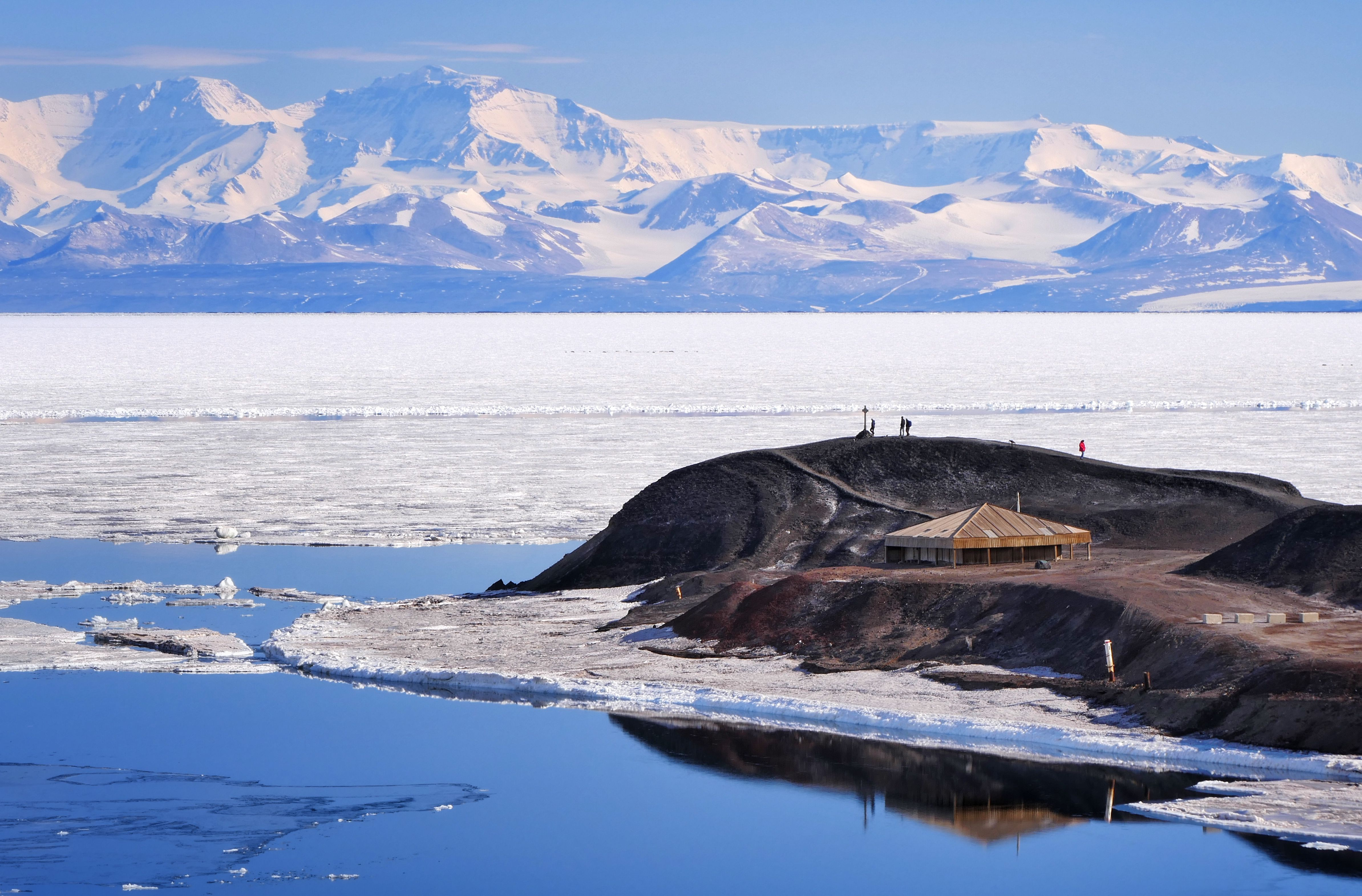 View over Scotts Discovery Hut and across McMurdo Sound to the Royal Society Range, McMurdo Station, Antarctica.