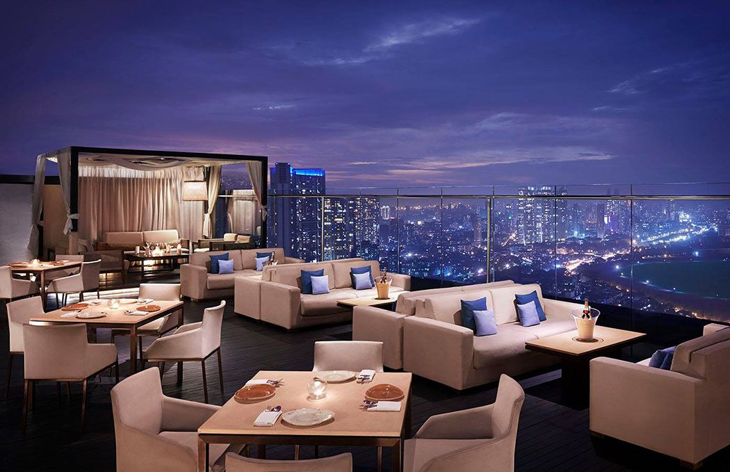 Seating on a rooftop bar in Mumbai at night