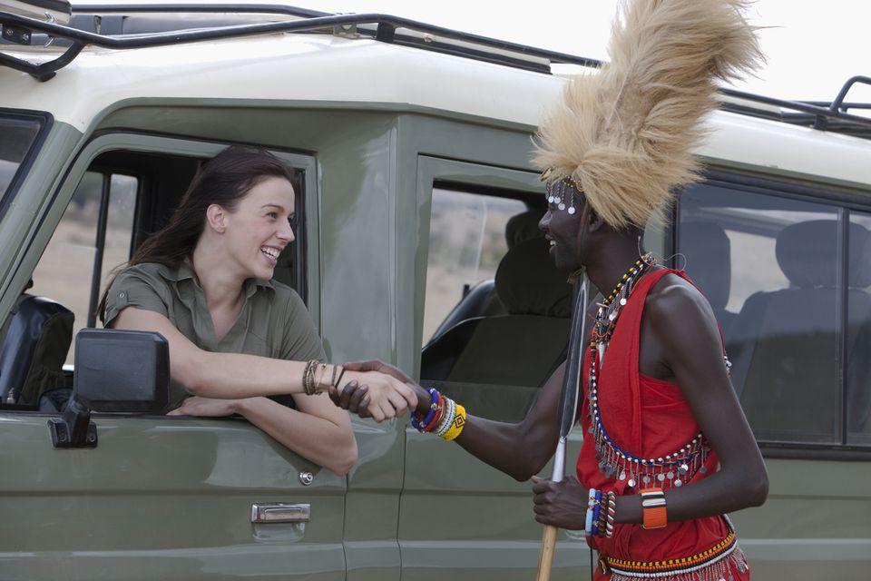 Tourist Thanking Tribesman, Kenya