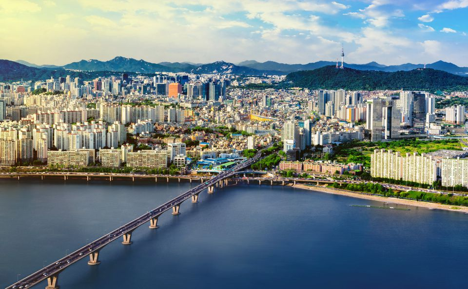 Aerial shot of Seoul City Skyline and N Seoul Tower with traffic bridge, South Korea