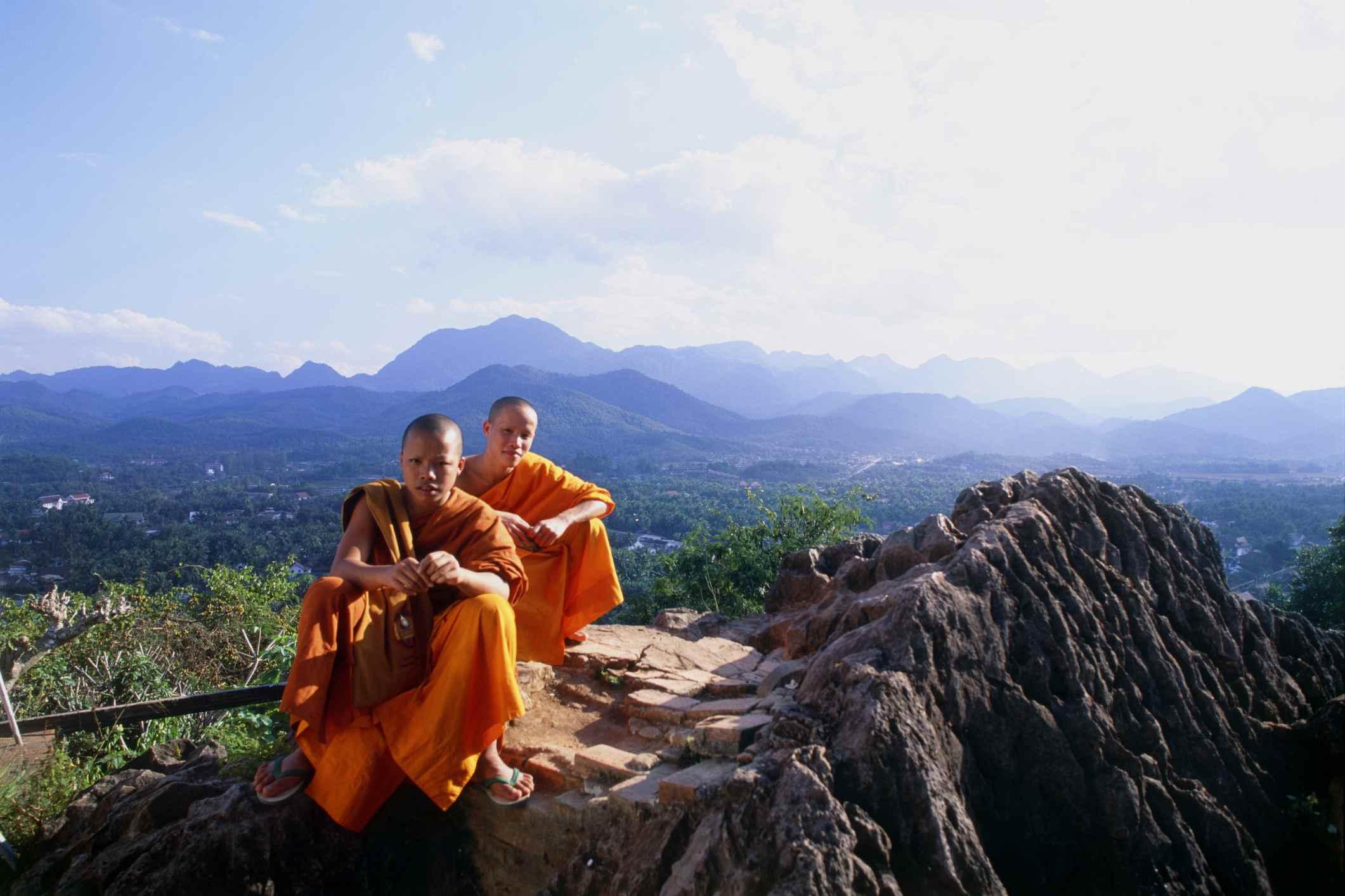 Monks on top of That Phousi, Luang Prabang