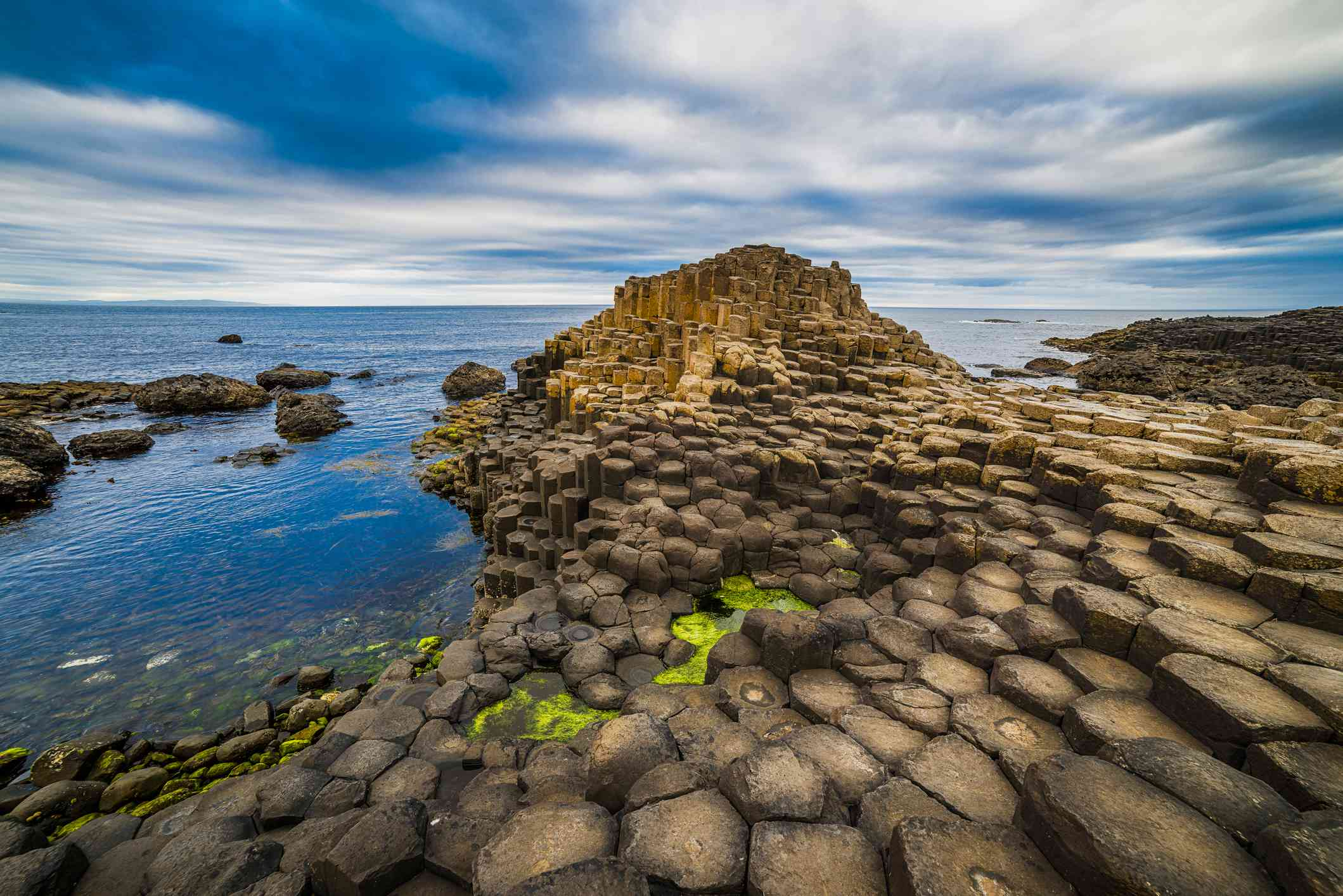 Bushmills, Northern Ireland - June 17, 2017: the Giant's Causeway is an area of about 40,000 interlocking basalt columns, a result of an ancient volcanic eruption. It was declared a World Heritage Site by UNESCO in 1986.