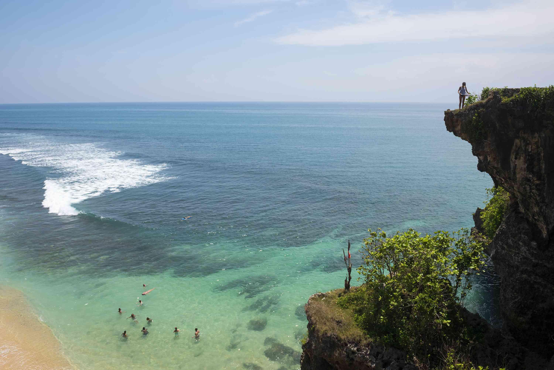 People and ocean at Balangan Beach in Bali