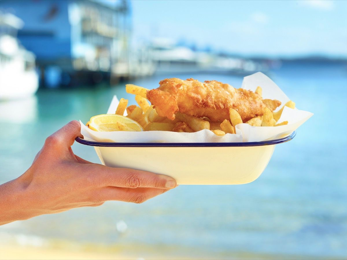 Fish and chips with the ocean in the background