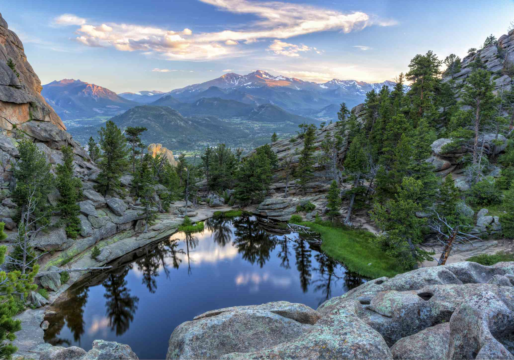 The last evening sunshine hits Longs Peak and The Crags above Gem Lake in Rocky Mountain National Park, Estes Park, Colorado