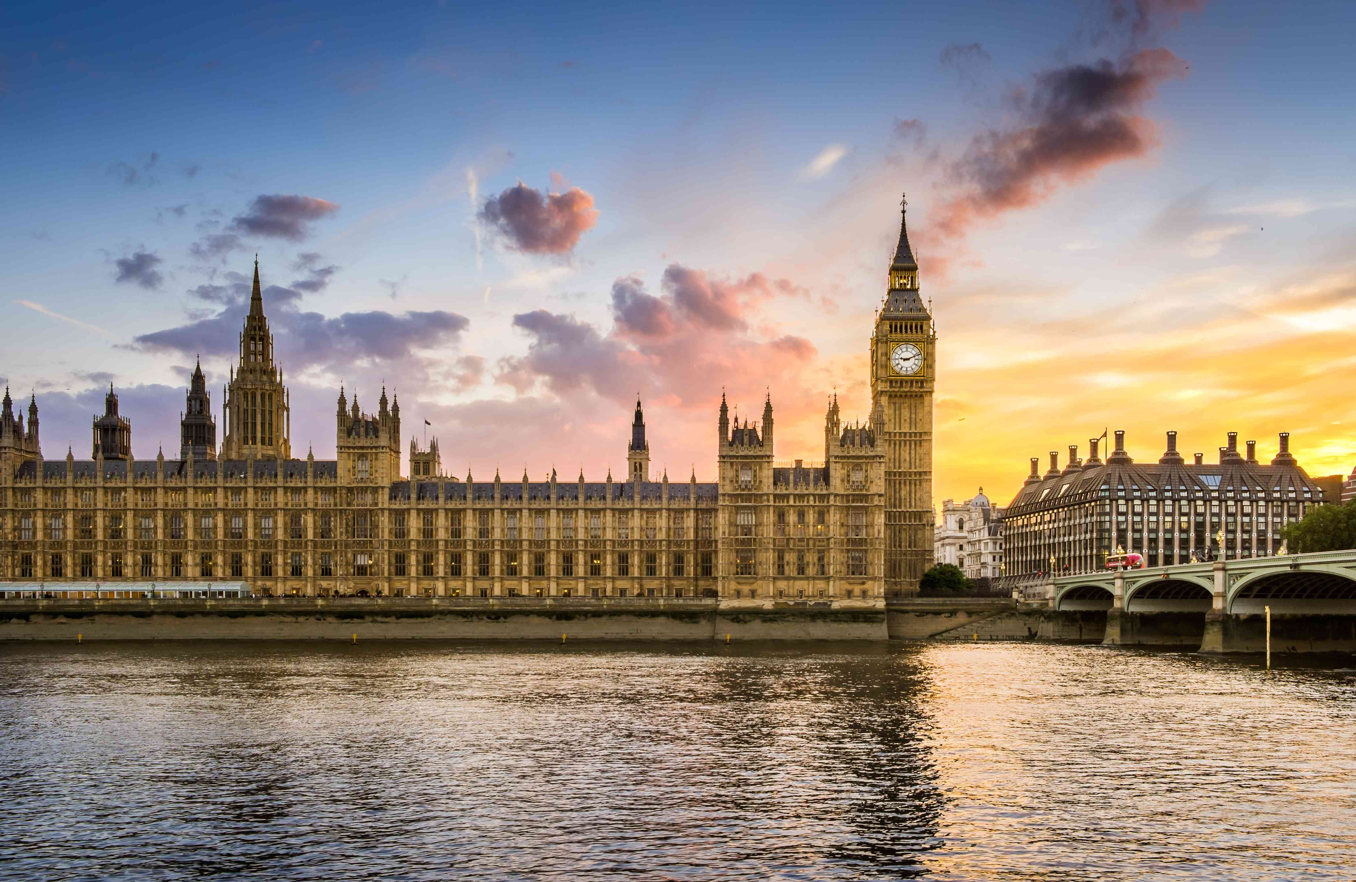 the house of parliament at sunset photographed from across the thames