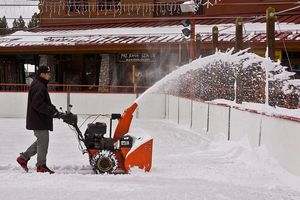 A man uses a snow blower to remove snow from an ice skating rink in Heavenly Village on March 8, 2013, in South Lake Tahoe, California. Lake Tahoe, straddling the border of California and Nevada, is the largest Alpine freshwater lake in the Western United States and a top tourism destination for skiers.