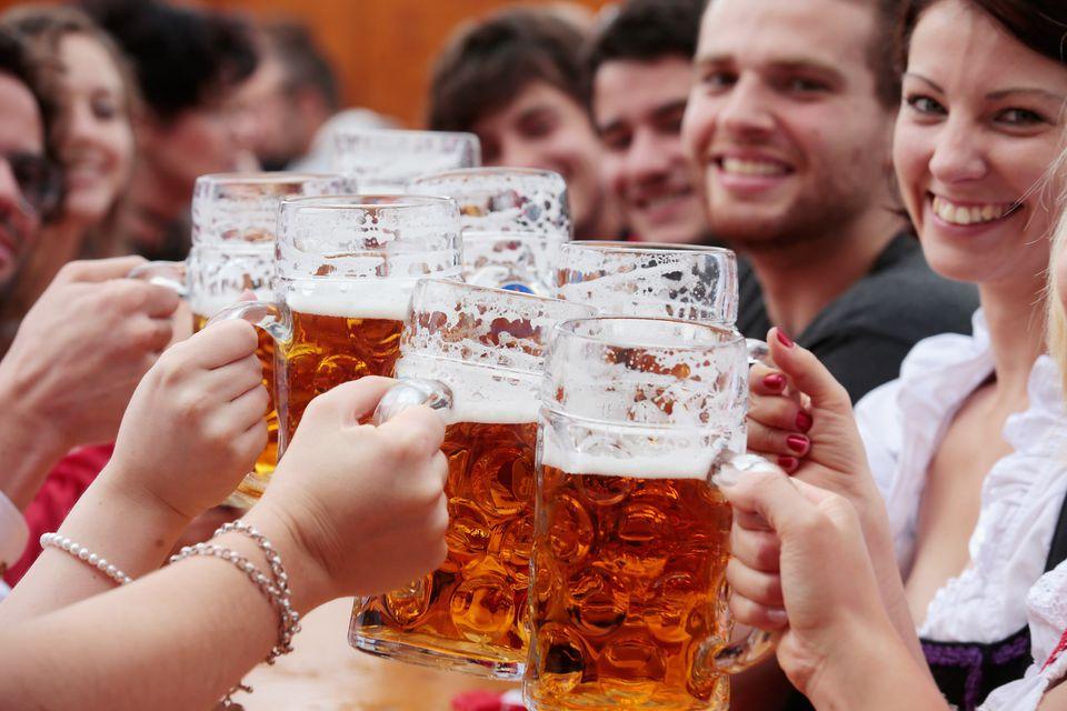 People cheersing with Oktoberfest beer