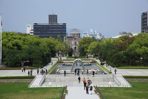 Fountain and square with people in front of a ruined building in Hiroshima city