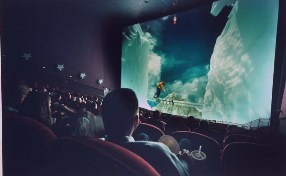 Audience watching film in IMAX theater